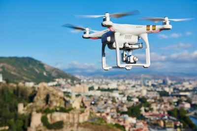 drone taking video for real estate agent by flying over sellers neighborhood